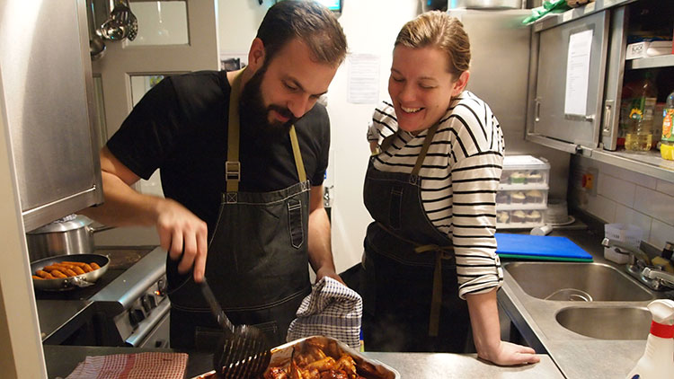 GrowTH volunteers Fiona and Rasmus Koefed-Jesperson preparing food for guests