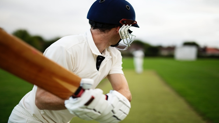 Person playing cricket