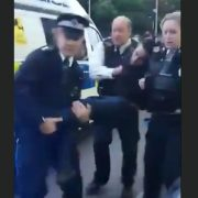 A bystander filmed police carrying an unconscious Khan into their police van