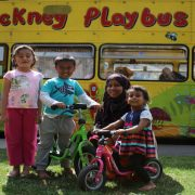 Family plays outside Hackney Playbus
