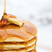 Honey drizzled on butter pancakes
